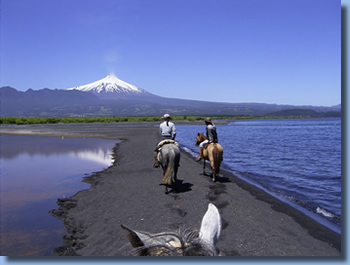 Riders on the banks of Lake Villarrica on a  day ride in Pucon, Chile